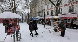 The snow-covered Place du Tertre, a square at the Butte Montmartre area in Paris yesterday as snow and freezing temperatures returned to northern France. Photograph: Reuters
