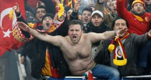 Galatasaray's supporters celebrate their team's victory over Schalke 04.