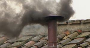 Black smoke rises from the chimney on the Sistine Chapel this morning. Photograph: Reuters