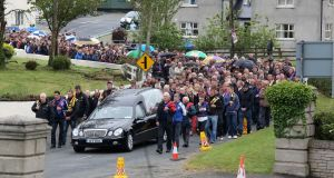 The funeral of Nicola Furlong making its way through the village of Curracloe in Co Wexford last June.
