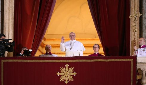 Pope Francis I waves to the waiting crowd from the central balcony of St Peter's. He is the 266th Pontiff and will lead the world's 1.2 billion Catholics.  Photograph: Getty