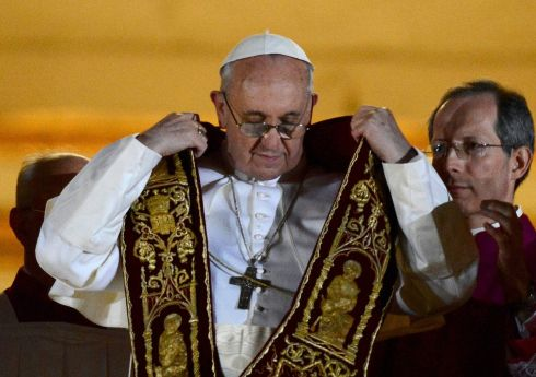 Pope Francis dons a stole, part of the liturgical vestment, after being elected by the conclave of cardinals.  Photograph: Reuters