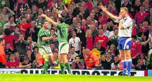 Wayne Barnes blows for full-time on Ireland's Grand Slam victory in Cardiff. Photograph: Alan Betson