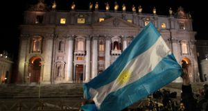 Argentina's flag  is waved after white smoke rose from the chimney above the Sistine Chapel, indicating a new pope had been elected, at the Vatican last evening.  Photograph: Giampiero Sposito/Reuters