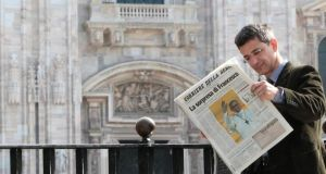 A man reads an Italian newspaper showing the newly elected Pope Francis on its front page. Photograph: Alessandro Garofalo/Reuters