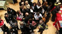 Job seekers wait to speak to representatives of employers at a job fair. Photo: Getty Images
