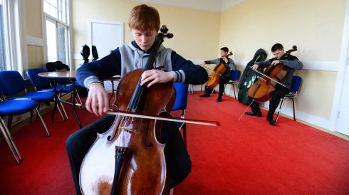 Patrick Moriarty from Dublin rehearsing before competing in the Senior Violin Cello competition at the RDS in Dublin during the 117th annual  Electric Ireland Feis Ceoil .  Photo: Bryan O'Brien / THE IRISH TIMES