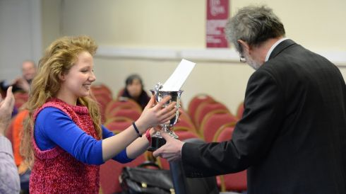 Ella Nagy, from Carlow winner of John Field Cup Piano U15 mix being presented with cup by adjudicator John York during the Electric Ireland Feis Ceoil.  Photo: Dara Mac Donaill / THE IRISH TIMES