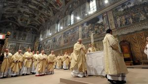 Newly elected Pope Francis leads a a mass with cardinals at the Sistine Chapel today. Photograph: Osservatore Romano/Reuters.