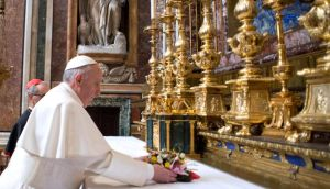Jorge Mario Bergoglio attends his first private Mass as Pope Francis in the Basilica of Santa Maria Maggiore in Rome yesterday. Photograph: Servizio Fotografico L'Osservatore Romano/Getty Images