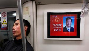A subway in Shanghai yesterday where a TV  screen shows   China's newly elected president  Xi Jinping. Photograph: Carlos Barria/Reuters