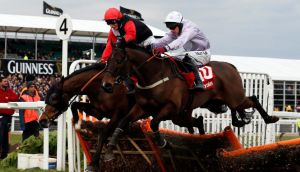 Paul Carberry pops Solwhit (right) over the last before landing the Ladbrokes World Hurdle.
