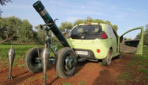 A  Free Syrian Army mortar attached to a car for pulling to the front line, to be used against forces loyal to Syria's president Bashar al-Assad. Photograph: Mohamed Kaddoor/Shaam News Network/Reuters