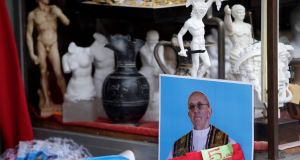 A picture of Pope Francis in a souvenir shop near the Vatican today. Photograph: Max Rossi/Reuters