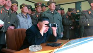 North Korean leader Kim Jong-un (C) and military officers watch a recent shell firing drill. Pyongyang has blamed South Korea and the United States for 'cyber attacks'. Photograph: Reuters/KCNA