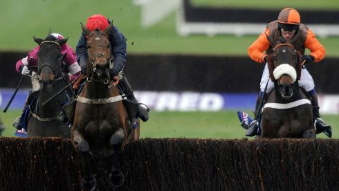 Bobs Worth (C, red cap) clear the last to win the Gold Cup. Photograph: Alan Crowhurst/Getty Images
