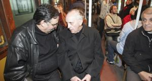 Pastoral care: Cardinal Bergoglio talks with a fellow passenger on the Buenos Aires underground in 2008. Photograph: Emiliano Lasalvia/LatinContent/Getty