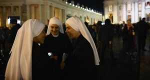 Excitement: nuns talk in St Peter's Square after the newly elected pope appeared on the balcony of the basilica on Wednesday evening. Photograph: Dan Kitwood/Getty