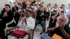 Vatican ambassador to Nicaragua Fortunatus Nwachukwu applauds as he watches a local television channel in Managua announce the election of Pope Francis. Photograph: Reuters
