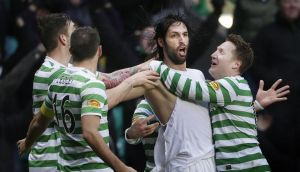 Celtic's Georgios Samaras (second right) celebrates his winning goal at Celtic Park. Photograph: Danny Lawson/PA Wire.