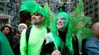 Steven Anderson and Kimberly Anderson watch the St Patrick's Day Parade in New York. Photograph: Carlo Allegri/Reuters
