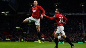 Manchester United's Wayne Rooney celebrates with Robin van Persie after scoring against Reading at Old Trafford. Photograph: Nigel Roddis/Reuters