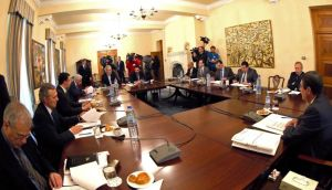 Cypriot president Nicos Anastasiades (R) and his cabinet sit at a meeting at the presidental palace in Nicosia. Photograph: Reuters