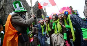 Visitors from Australia join the People's Parade during festivities on Dublin's O'Connell Street. Photograph: Alan Betson /The Irish Times