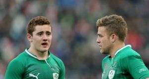 Ireland's Paddy Jackson (left) and Ian Madigan dejected after defeat to Italy in Rome. Photograph: James Crombie/Inpho