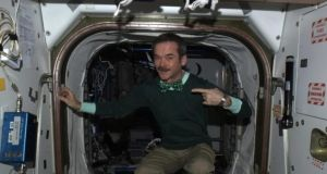 Commander Chris Hadfield tweeted a photo of himself wearing green for St Patrick's Day from space today. Photograph: @Cmdr_Hadfield
