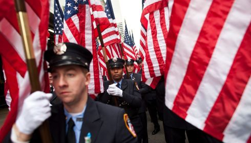 Members of FDNY march on New York's Fifth Avenue during the 252nd annual St Patrick's Day Parade. Photograph: Ramin Talaie/Getty Images