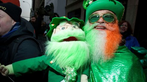 Dennis O'Mann and his doll watch the St. Patrick's Day Parade in New York. Photograph: Carlo Allegri/Reuters