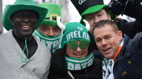 Babon Njiel from Gambia; Kamil and Meg Borawscy from Poland; and Howard Davis and Mark Harrison from Yorkshire get in to the spirit of St Patricks Day on O'Connell Street, Dublin. Photograph: Alan Betson/The Irish Times