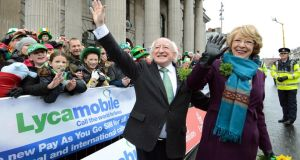 President Michael D Higgins with his wife Sabina photographed during the St Patrick's Day Parade in Dublin today. Photograph: Brenda Fitzsimons/The Irish Times