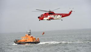 File photograph of an  Irish Coast Guard rescue. A helicopter airlifted two teenagers to safety today after they became stranded on rocks off the coast of Greystones.  Photograph: Dara Mac Donaill/The Irish Times