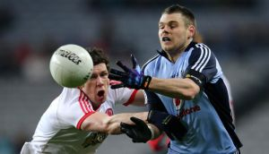 Tyrone's Sean Cavanagh tackles Dublin's Kevin McManamon during Saturday night's clash at Croke Park. Photo: Cathal Noonan/Inpho