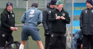 Giovanni Trapattoni chats with Stephen Kelly at training yesterday. Photograph: Donall Farmer/Inpho