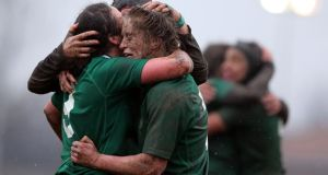 Ireland's Claire Molloy, Larissa Muldoon and Joy Neville celebrate after securing the Grand Slam against Italy.