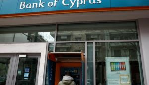 A man withdraws money from an automatic teller machine at a branch of Bank of Cyprus. A euro zone proposal would see Cyprus receive a bailout worth ¤10 billion but it has demanded depositors in its banks forfeit some money to stave off bankruptcy. Photograph: Reuters
