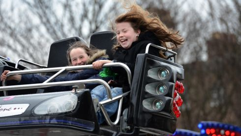 Saoirse Darby, Dartry (left) and Meadhbh Egan, Clontarf, enjoying the funfair at Marrion Square, Dublin during the Monday Bank Holiday St. Patricks Festival. Photo: Dara Mac Donaill / THE IRISH TIMES