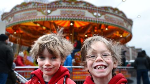 Brothers Daniel (left) and Nick Brabazon, from Clontarf, enjoying the funfair at Marrion Square, Dublin during the Monday Bank Holiday St. Patricks Festival. Photo: Dara Mac D?naill / THE IRISH TIMES