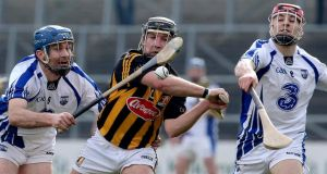 Kilkenny's Richie Hogan comes under pressure from Michael Walsh and Shane O'Sullivan of Waterford. Photograph: Lorraine O'Sullivan/Inpho