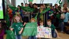 Family and friends waiting for the return of the Ireland Women's Rugby team that won the RBS 6 Nations Cup and secured an historic first grand slam. Photograph: Brenda Fitzsimons/The Irish Times