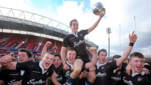 Crescent captain Gearoid Lyons is held aloft by teammates after the game at Thomond Park. Photograph: Cathal Noonan/Inpho