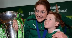 Fiona Coughlan, captain of the triumphant Ireland women's rugby team, with her nephew Charlie Coughlan.