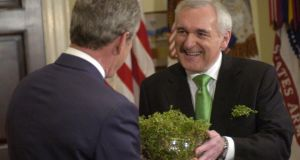 Bertie Ahern, then taoiseach, gives then US president George W Bush a bowl of shamrock during a White House ceremony on St Patrick's Day in 2006.  Photograph Leslie E Kossoff/LK Photos