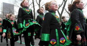 Members of the Emerald Isle Step Dancers, from Wilkes-Barre, Pennsylvania, make their way up New York's Fifth Avenue as they take part in the St Patrick's Day Parade. Photograph: Tina Fineberg/AP