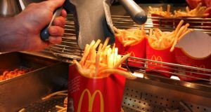 Fries are prepared for customers at McDonald's. Donal O'Shea, a consultant endocrinologist, has said the Government should consider pulling its financial support from the FAI because of its new partnership with the fast-food chain.