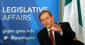 Taoiseach Enda Kenny waves to the audience gathered before giving a speech to the George Washington University's Graduate School of Political Management in Washington. Photograph: Reuters