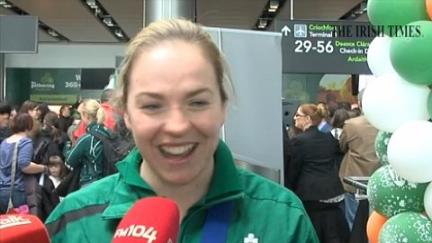 Winning Irish ladies rugby team return to rousing reception at Dublin airport